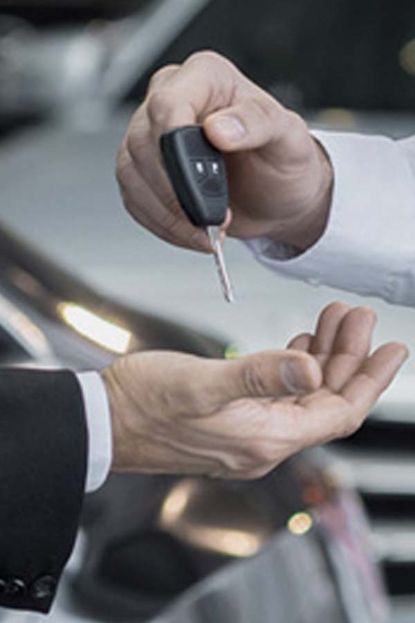 Replacement Mercedes car keys being handed over